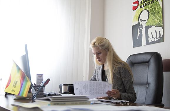 Svitlana Zalishchuk, a member of Ukraine's national parliament, reviews a bill in her office in Kiev.
