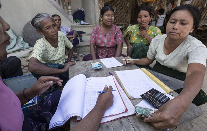 WORTH members in Gon Kon village make savings deposits.