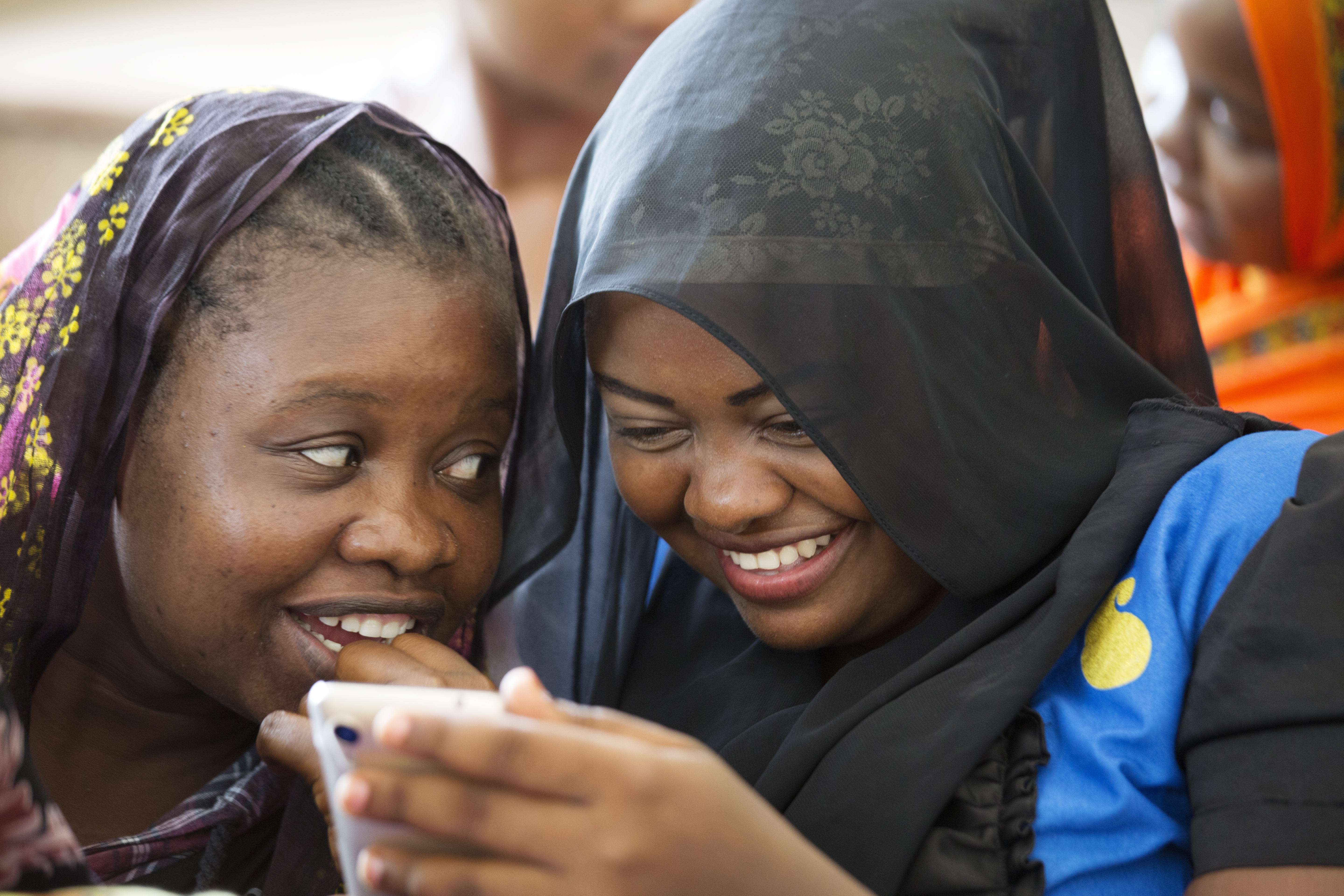 Mobile technology provides a fun way for two young WORTH women to learn and explore ways to expand their businesses.
