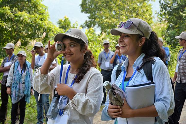Usha Humagain and Dikshya Dahal take part in field work.