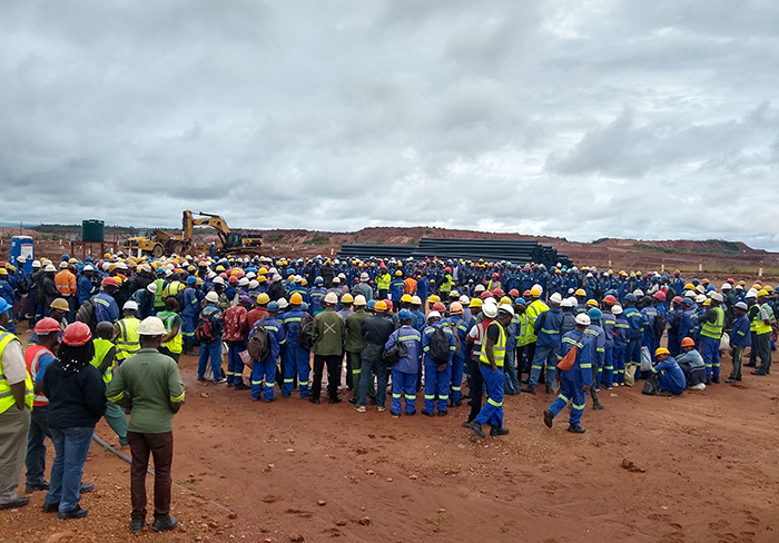 Miners and others gather at the Mutoshi site.