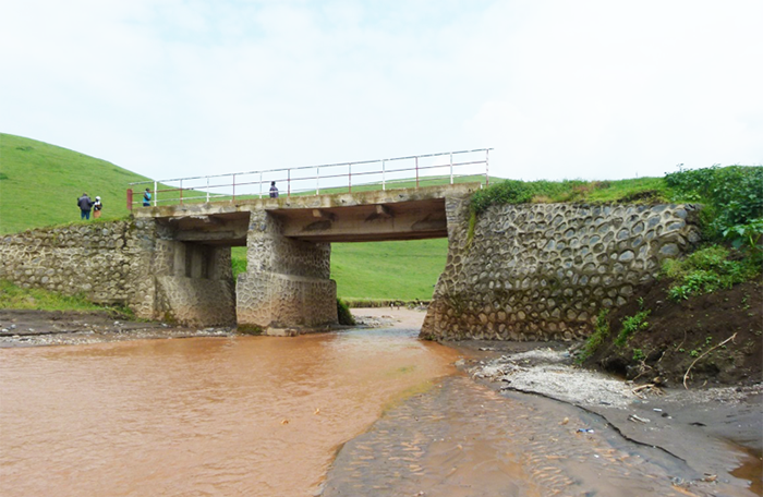Before and after the Bihambwe and Mema bridges were built using community revenue generated through responsible mining.