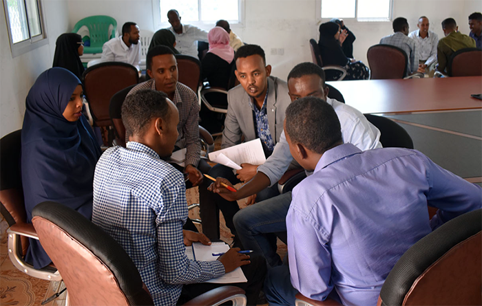 Participants hold a group discussion during the master class.