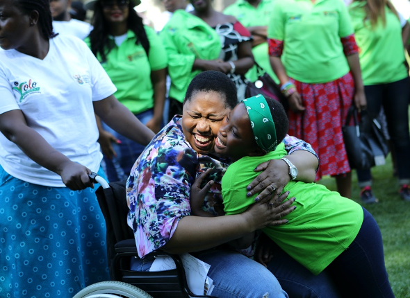 DSD Deputy Minister Hendrietta Bogopane-Zulu hugs a child during a ChommY launch event in Johannesburg. (Photo: Tanja Bencun-Roberts/Pact)