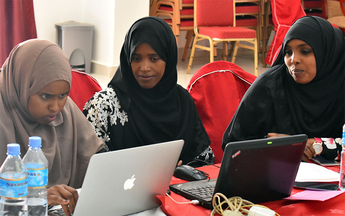 Yasmin Abdi Abdulli, center, participates in a group discussion during the workshop.