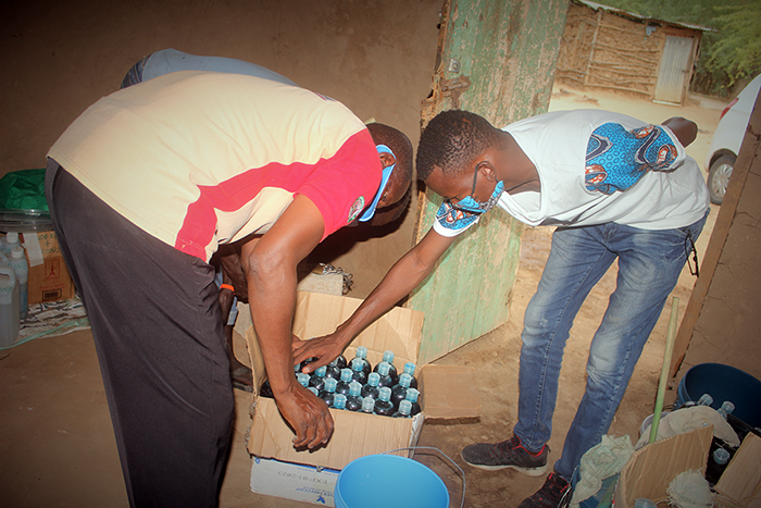 Containers of liquid soap manufactured by members of ERUKO self-help group are counted and packaged, ready for distribution. (Photo: SEEK)