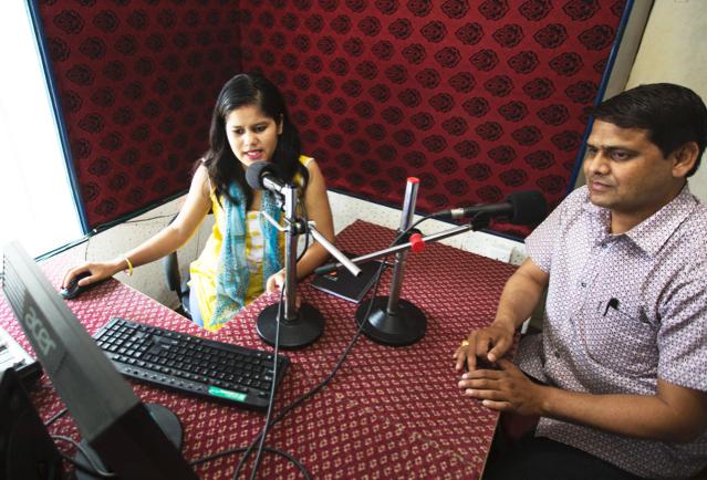 Sabitri Giri, a producer at Krishnasar FM in Nepalgunj, works on a broadcast.