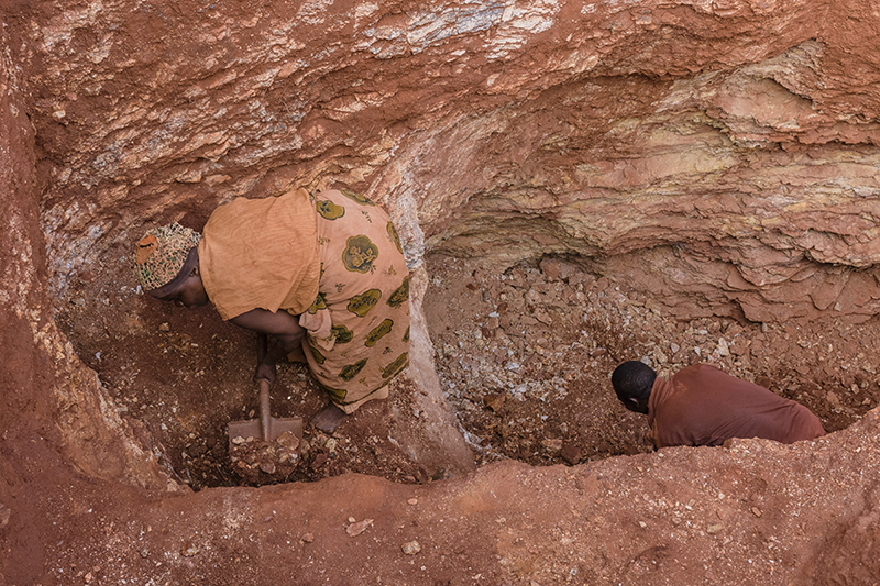 Small-scale mining is among the hardest labor people do. Here, Asha, a tourmaline miner in Tanga, works her claim with another miner.