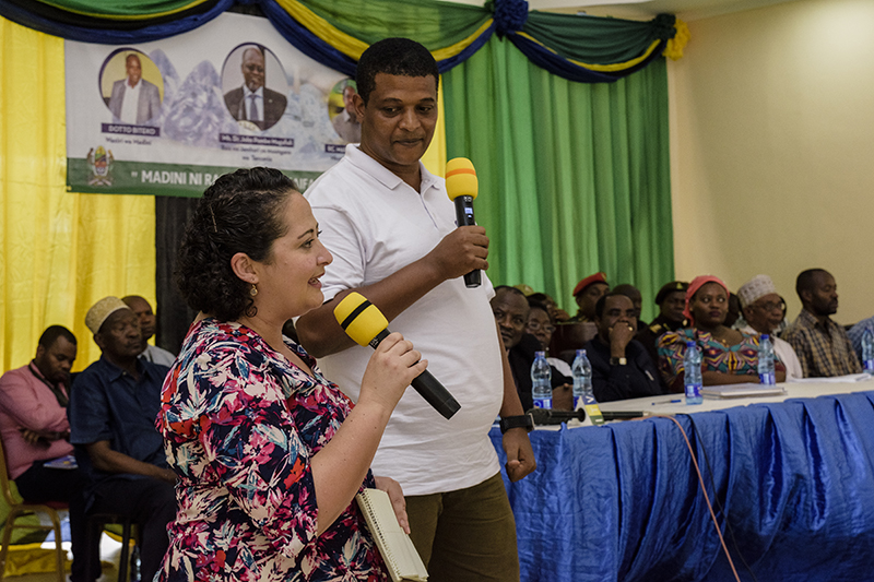Cristina Villegas and Pact's Norbert Massay address the crowd during the opening ceremony for Moyo Gems' first Market Day.