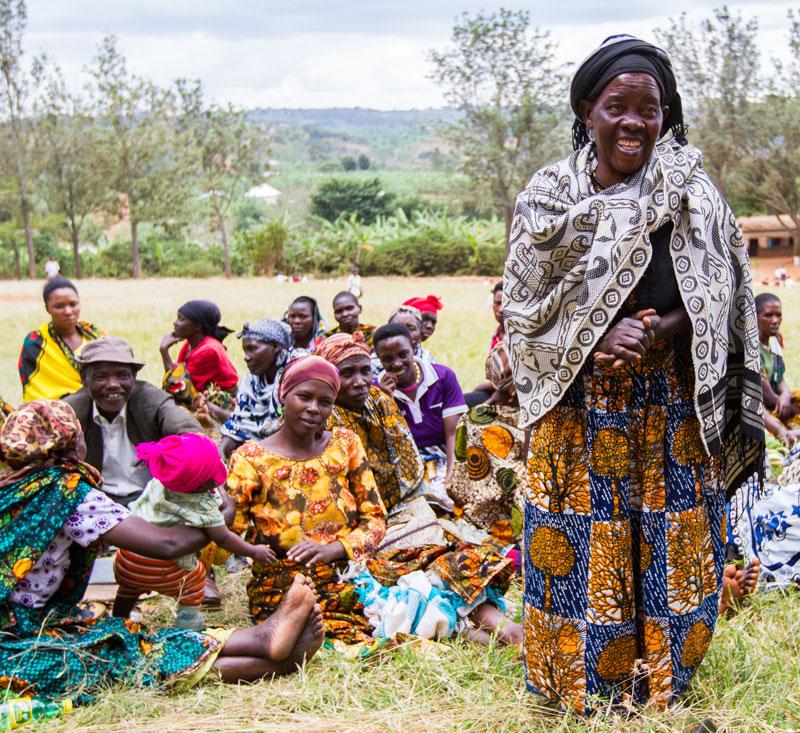 Domitina Thomas tells her story while her fellow WORTH women listen.