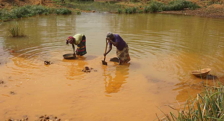 Women panning gold in Sierra Leone.