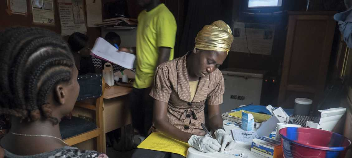 A pregnant woman in Nigeria receives care at a PMTCT site.