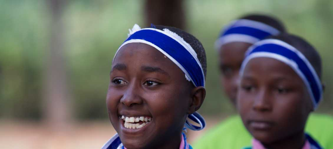 Children take part in an OVC program in Tanzania aimed at reducing HIV infections. (Photo: Eddie Byrd/Pact)