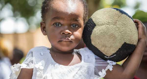 Young girl holding a ball in Tanzania
