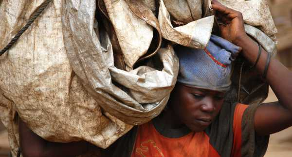 A miner in Democratic Republic of Congo carries materials.