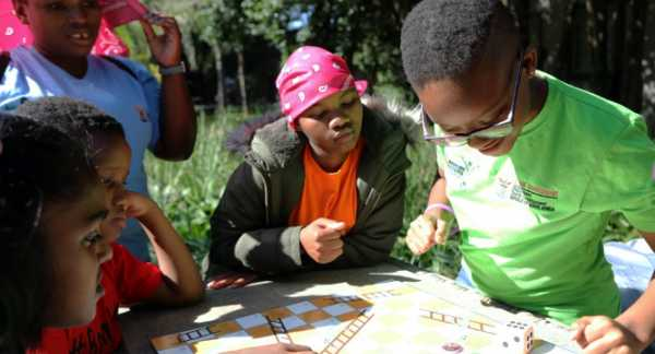 Children play games as part of ChommY, a GCBS-supported program designed to reduce risky behavior and HIV infections among 10-to-14 year olds. (Credit: Tanja Bencun-Roberts/Pact)