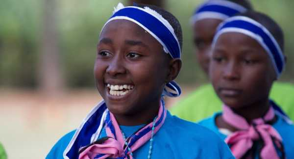 A Tanzania girl participates in a kids club as part of Pact's Pamoja Tuwalee project.