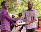 A BVC member in Mangochi presents a petition to the chair of the PCAIWD committee, Chidanti Malunga.