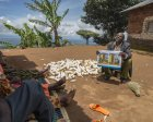 A community health worker in Tanzania provides counseling to community members.