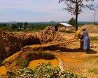 Woman sluicing gold-bearing ore on Gori Maria mine site in Mikei, Migori, Kenya. (Credit: Jorden de Haan/Pact)