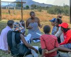 """A Young Heroes """"life mentor"""" facilitates a small-group session on HIV prevention for adolescent girls in Eswatini before the Covid-19 pandemic. (Credit: Young Heroes)"""