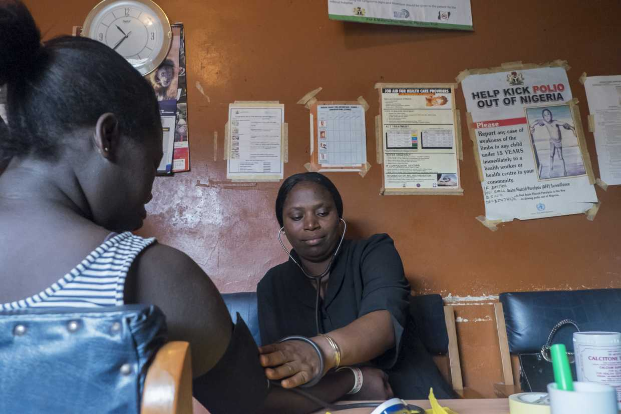 Pregnant woman visits a local clinic in Nigeria as part of the PROMOT II project.