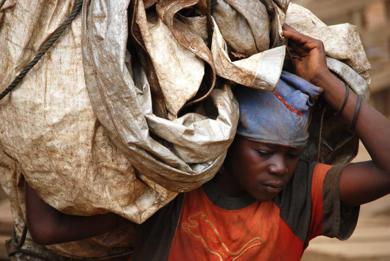 A miner in Democratic Republic of Congo carries materials.