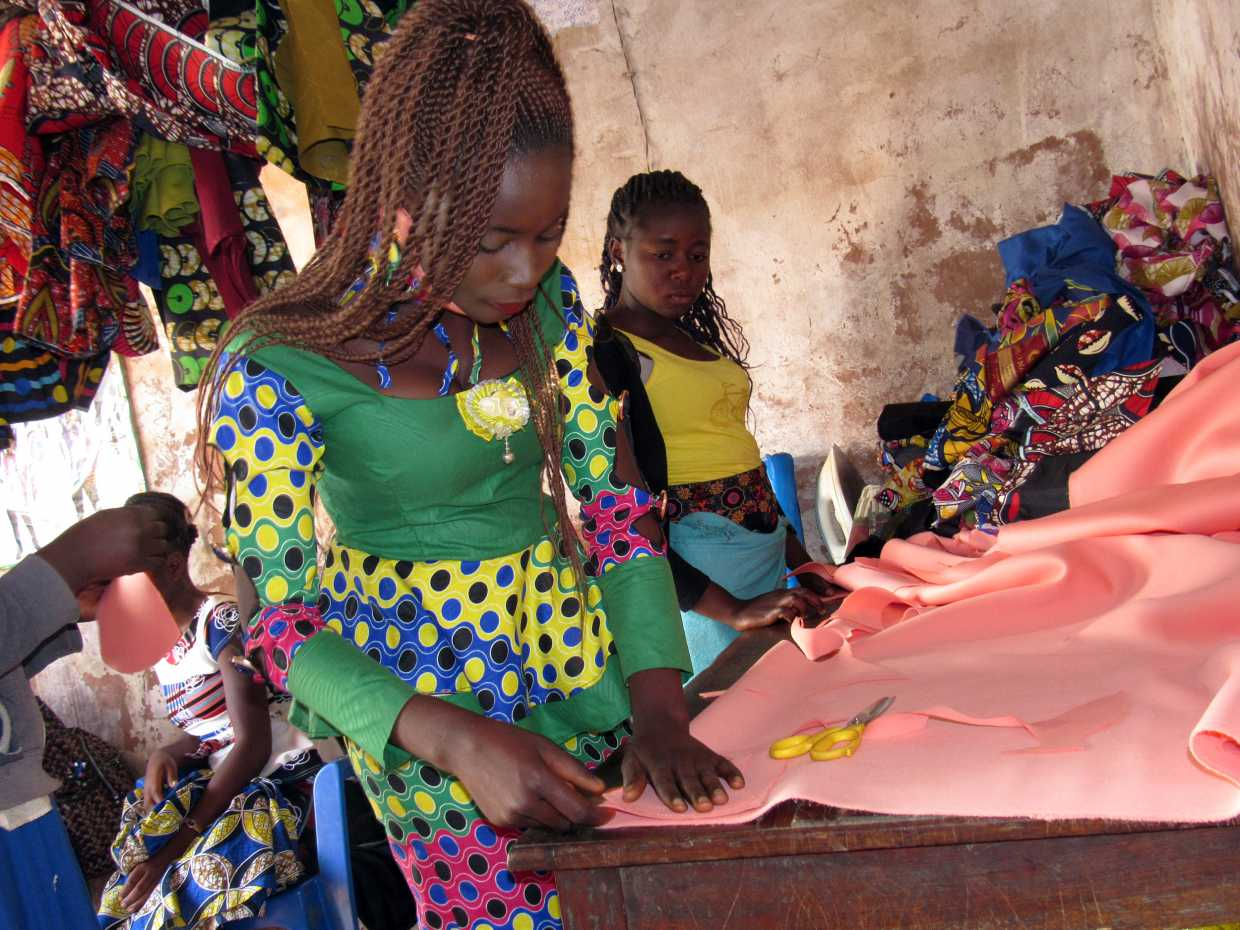 Sewing apprentices cut fabric to make Covid-19 face masks. (Photo: Pact)