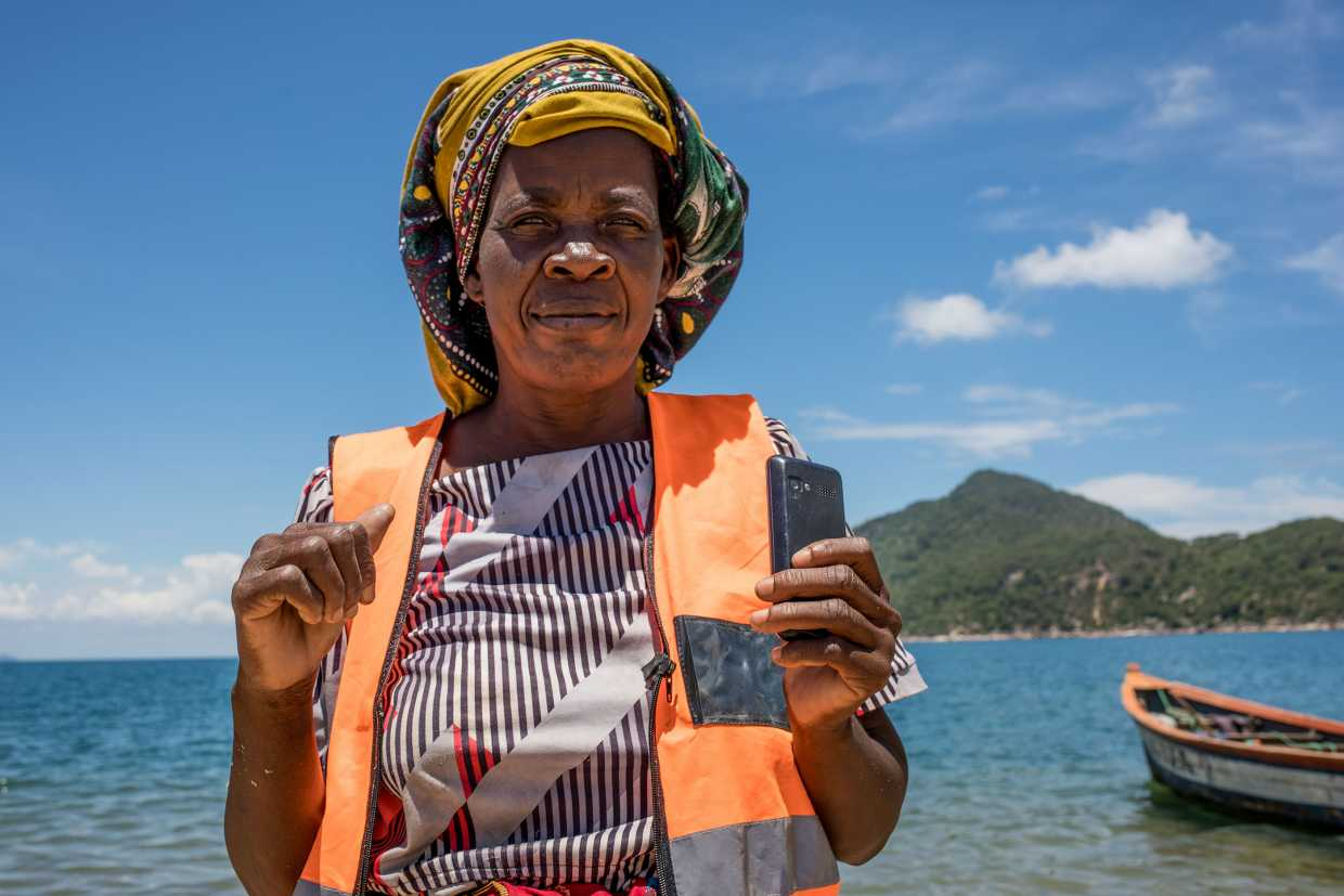 A community volunteer in Malawi with the FISH project, one of approximately 100 projects from which Pact gathered impact data in 2019.