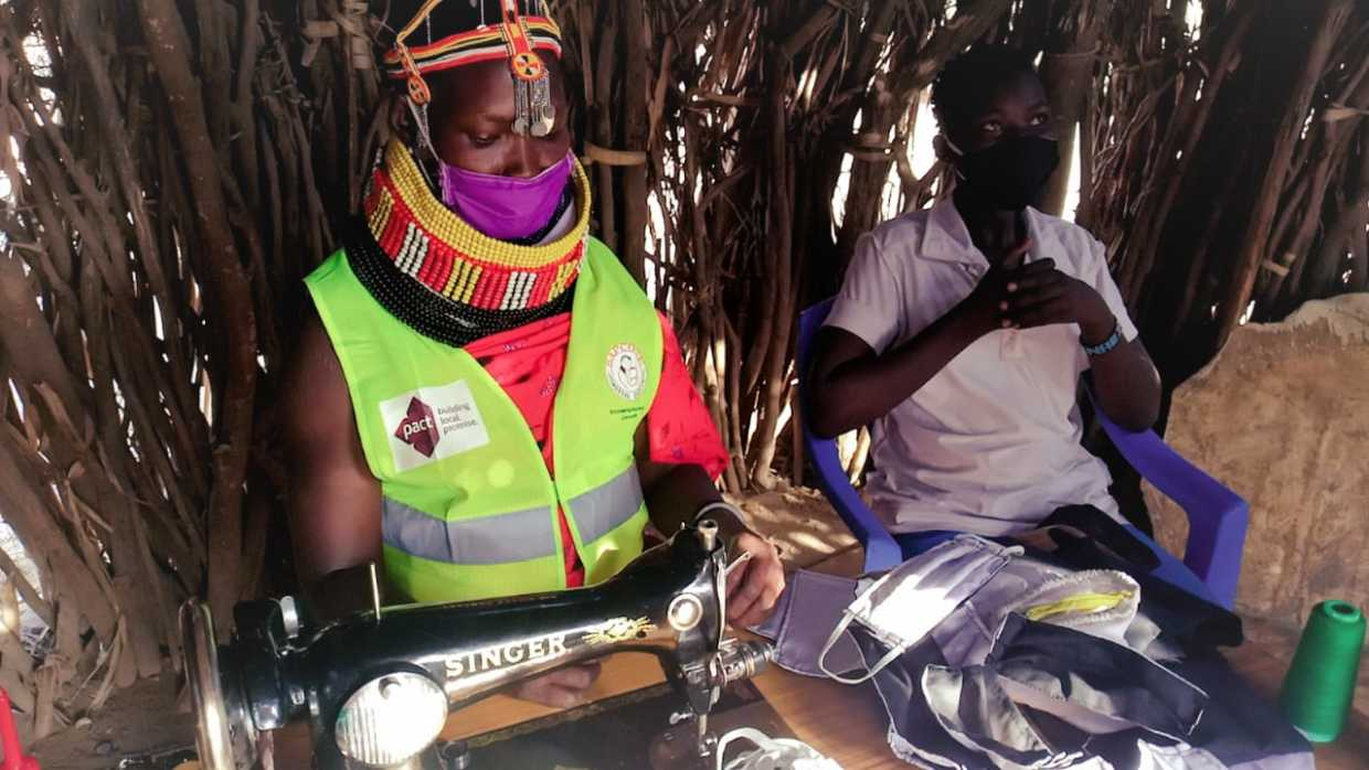Mariana sews face masks for sale in her village, Loarengak, in Turkana County. She has so far produced 20,000 face masks for purchase and distribution by SAPCONE, a SEEK project consortium partner. (Photo: Pact)