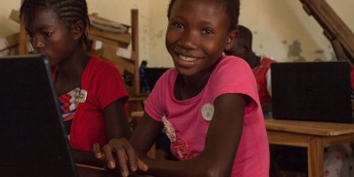A young girl in a classroom in DRC.