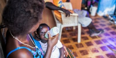 A mother in Bayelsa State, Nigeria, feeds her baby. (Credit: Pact)