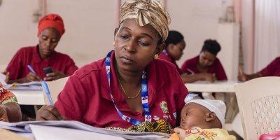 A Kizazi Kipya community case worker. Credit: Michael Goima/Pact