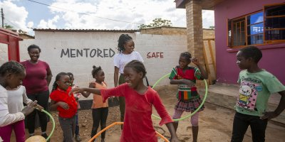 Girls play outside a DREAMS center in Lusaka, Zambia. Credit: Brian Clark/Pact