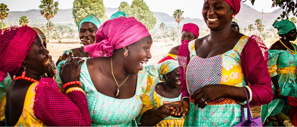 caption: With training they received through a Pact mothers group in Nigeria, these women run their own small business making soap and knitted goods.