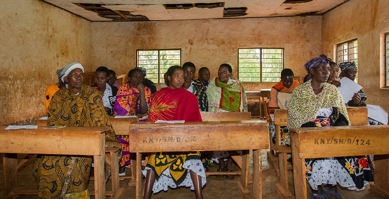 caption: A Pact WORTH group meets in Kituntu, Tanzania.