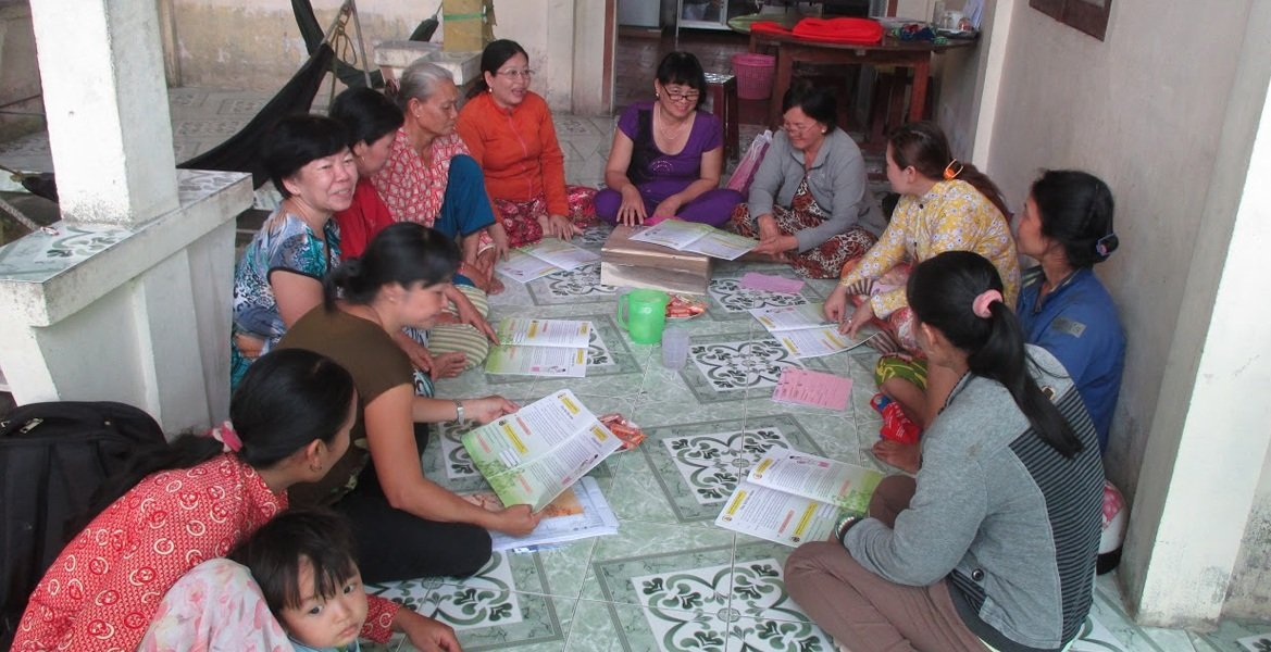 caption: A WORTH group meets in Vietnam's Mekong Delta region.