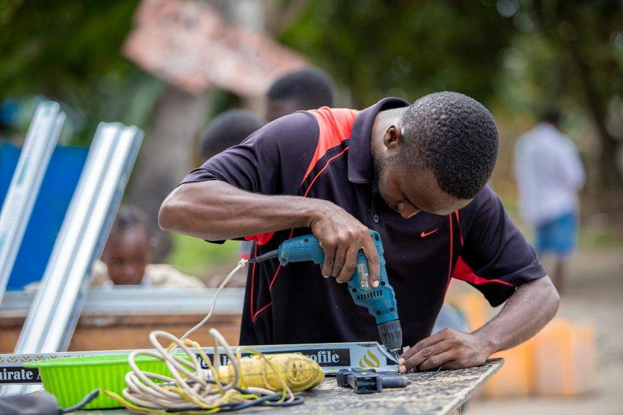 Qadir, one of nearly 10,000 youth who received vocational scholarships and income-generating start-up kits through Kizazi Kipya. Credit: Aidan Tarimo/Pact