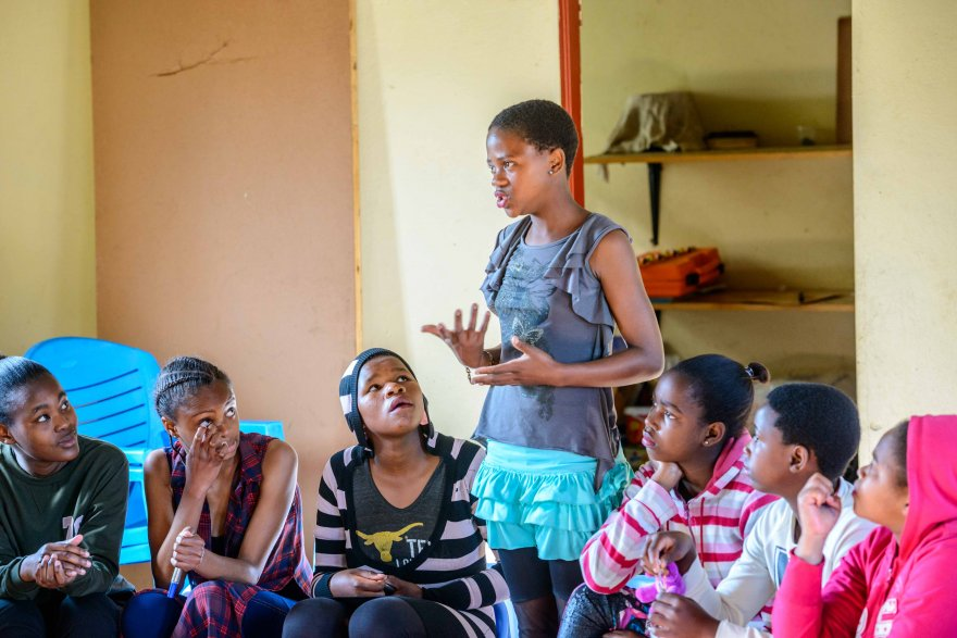 An adolescent girl shares her thoughts on relationships with her group members during a Young Heroes session. (Credit: Young Heroes)