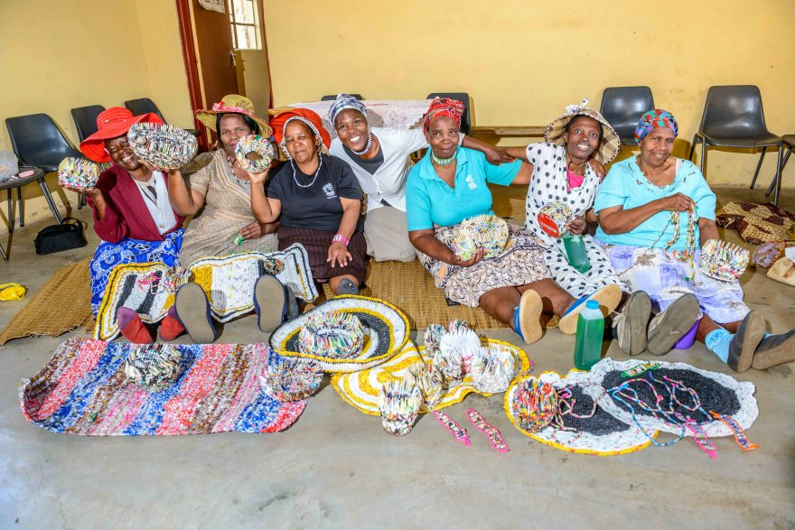 Members of a WORTH group run by Young Heroes. The group makes handcrafts from recycled materials that they then sell. With the profits, they provide for their children. (Credit: Young Heroes)