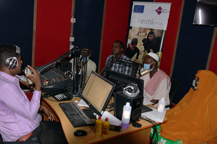 RASMI boundary partners and local public health officials take part in a Dawa FM radio talk show to raise awareness about stopping the spread of Covid-19. (Photo: RASMI)